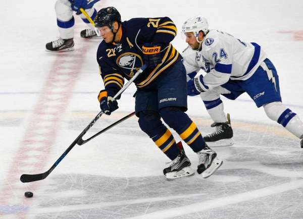 Buffalo Sabres forward Kyle Okposo skates past Tampa