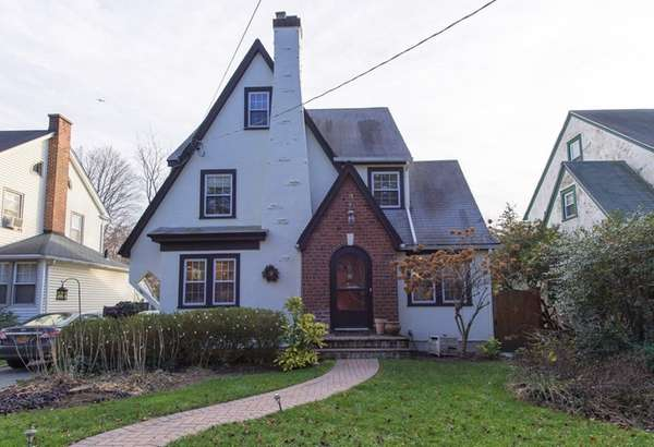 This four-bedroom Tudor-style home in Glen Cove is