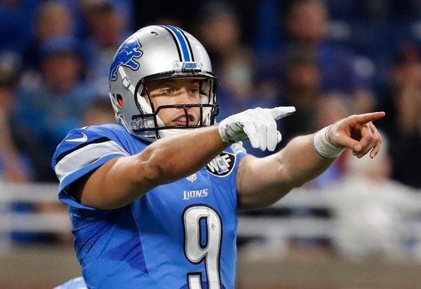 Detroit Lions quarterback Matthew Stafford (9) points out