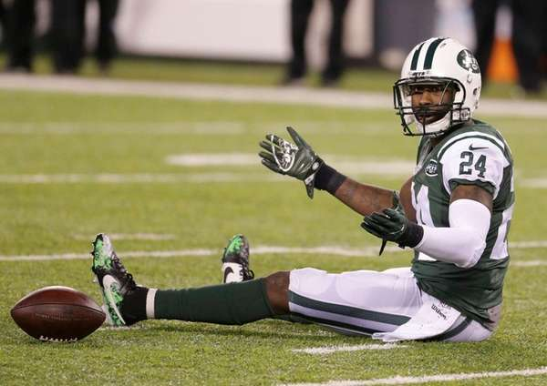 New York Jets cornerback Darrelle Revis reacts after