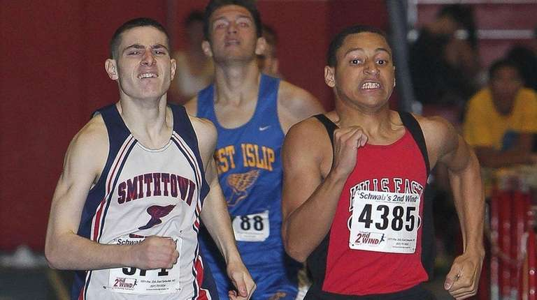 Matthew Villano of Smithtown West overtakes Christian Sam