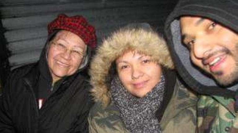 Maria Ayala, 62, in the red hat, (left),