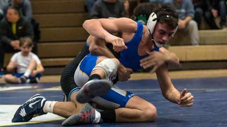 Rocky Point's Anthony Cirillo, rear, takes down Hauppauge's