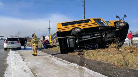 An overturned bus is at the scene of