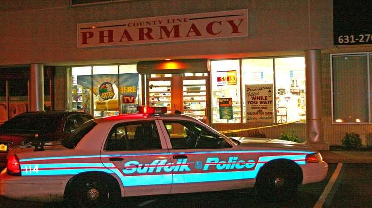 Suffolk County police investigate the robbery Thursday, Dec.