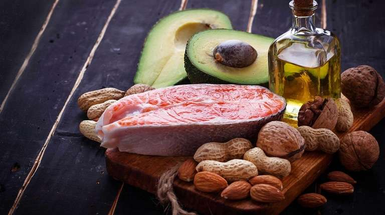 Salmon, avocado, olive oil and nuts provide healthy