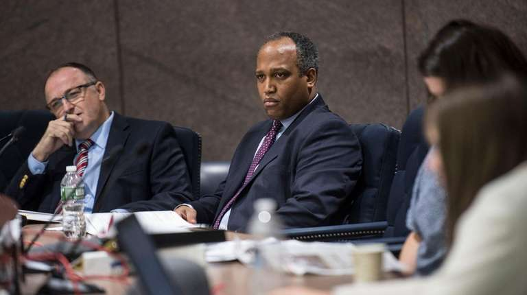 Suffolk Legislature's Presiding Officer Duwayne Gregory listens to