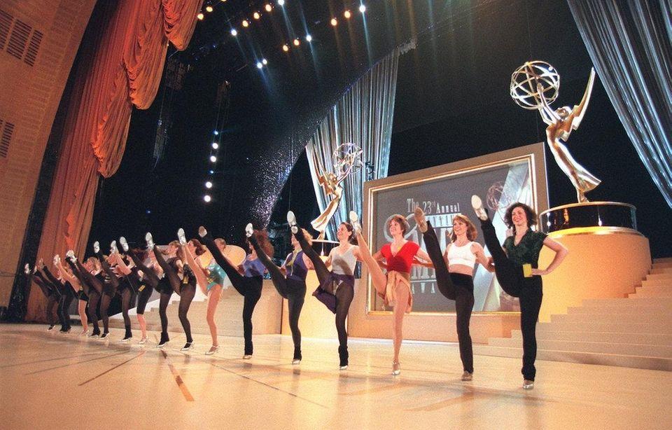 The Radio City Rockettes do a high-kick line