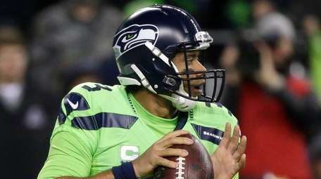 Seattle Seahawks quarterback Russell Wilson passes against the