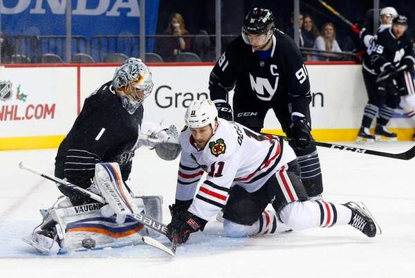 Islanders goalie Thomas Greiss makes a first-period save
