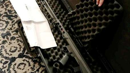 A 51-pound package containing an assault rifle was