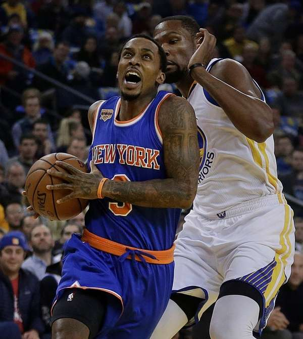 New York Knicks' Brandon Jennings, left, drives the