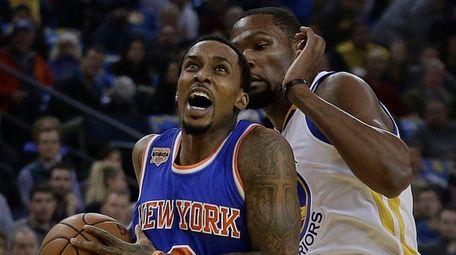 New York Knicks' Brandon Jennings, left, drives the