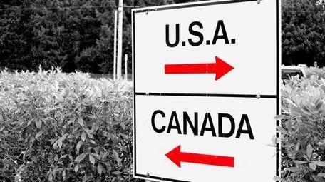 A sign at the U.S. -Canada border