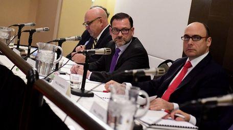 NIFA chairman Adam Barsky, center, presides over a
