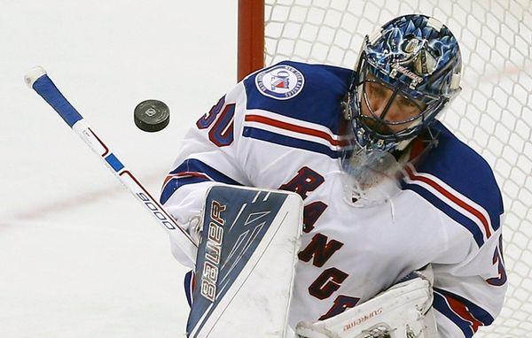 New York Rangers goalie Henrik Lundqvist (30) deflects