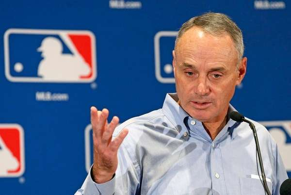 Baseball Commissioner Rob Manfred answers a question as
