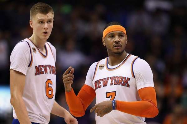 Kristaps Porzingis #6 and Carmelo Anthony #7 of