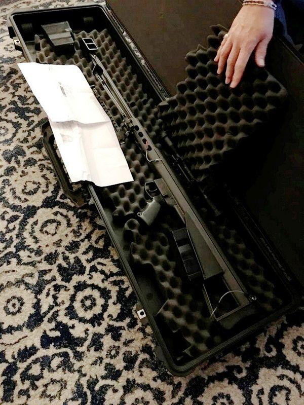 A 50-caliber Barrett rifle worth about $10,000 was