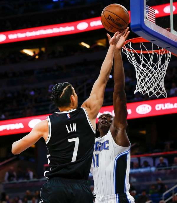 Nets guard Jeremy Lin shoots over the Magic's