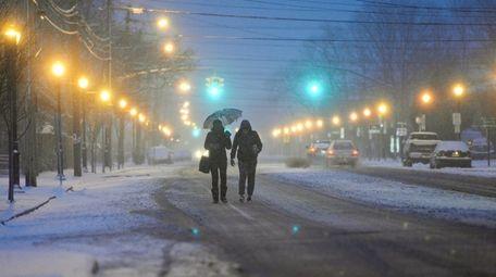 Two women walk along Prospect Avenue in New