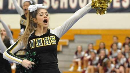 Nicole D'Angelo and the Ward Melville cheerleaders perform