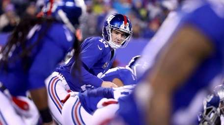 Eli Manning of the Giants looks on