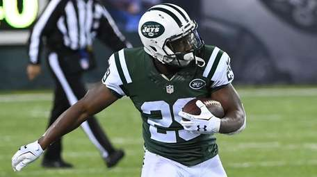 New York Jets running back Bilal Powell runs