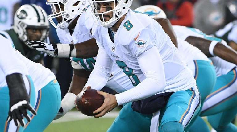 Miami Dolphins quarterback Matt Moore looks to hand
