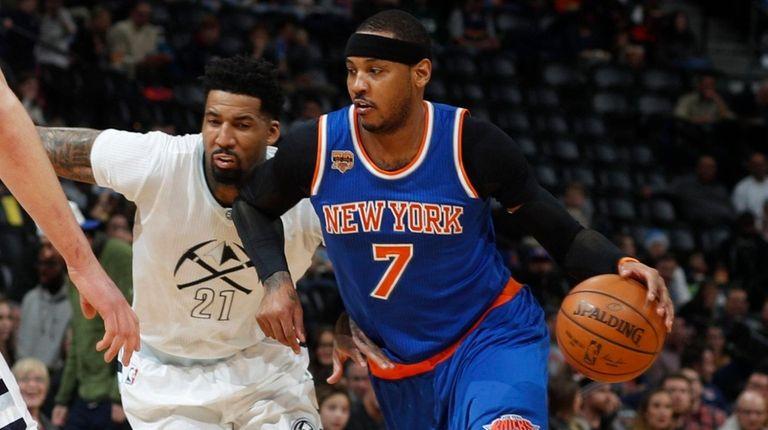 New York Knicks forward Carmelo Anthony, right, drives