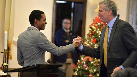 New York City Mayor Bill de Blasio shakes