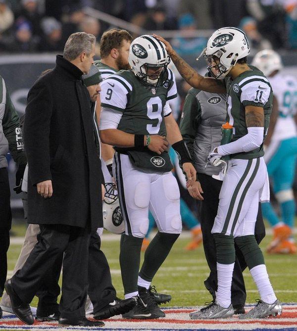 New York Jets quarterback Bryce Petty walks off