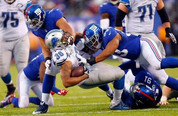 Dwayne Washington of the Detroit Lions is stopped