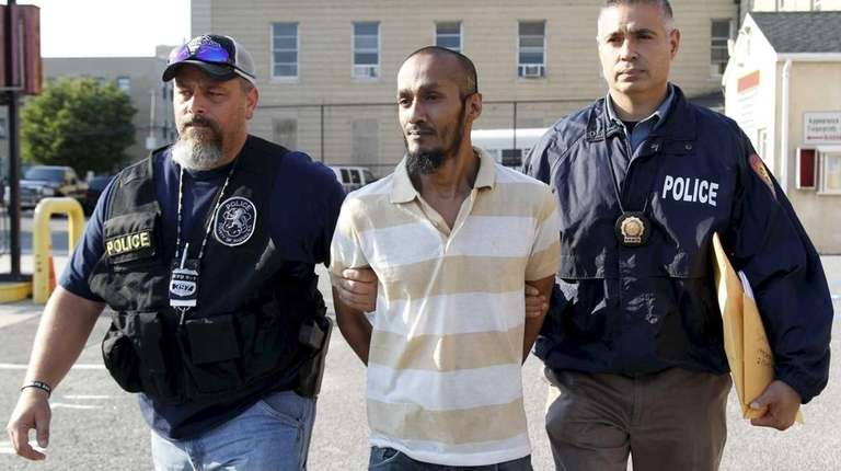 Balkumar Singh, escorted from Nassau police headquarters in
