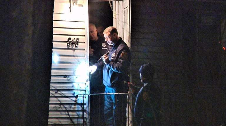 Suffolk County police investigate the scene on Bayview