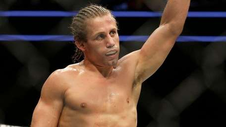 Urijah Faber waves after beating Brad Pickett by