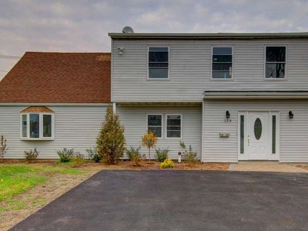 This five-bedroom, 3.5-bath home in Levittown was recently