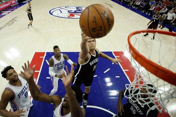 Brooklyn Nets' Brook Lopez tips in a rebound