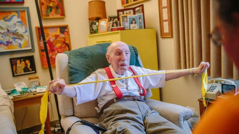 Melvin Judkis, 98, does stretches with Michael Majoris,