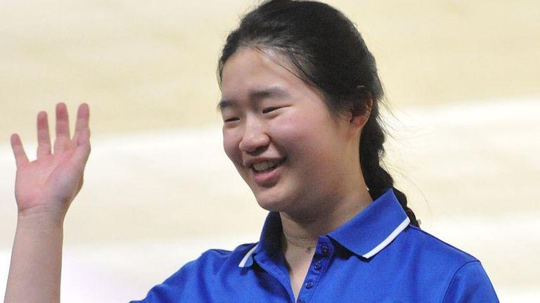 Joyce Lin of Port Washington reacts after making