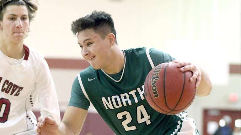 Valley Stream North's John Alimo dribbles past a