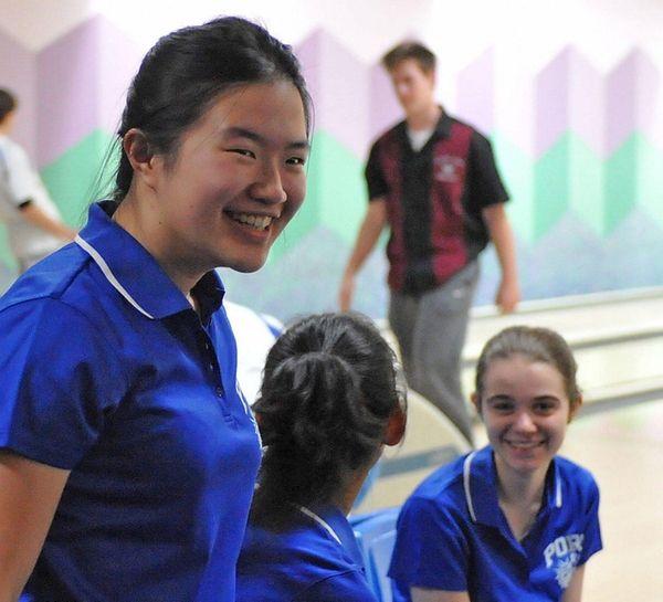 Joyce Lin of Port Washington reacts after bowling