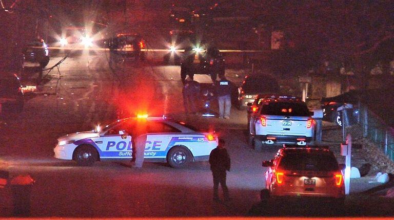 Suffolk County police investigate the scene where they