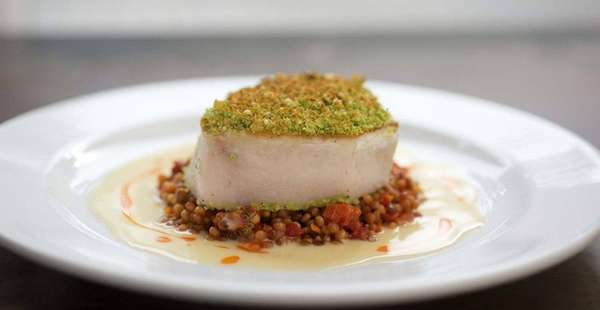 Hazelnut-Parmesan-crusted swordfish is a main course at H2O