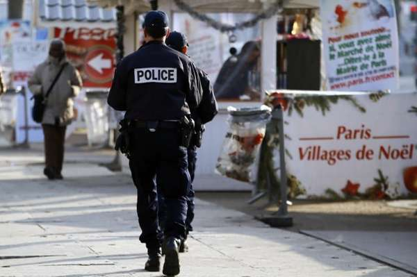 French police officers patrol in the Champs-Elysee Christmas