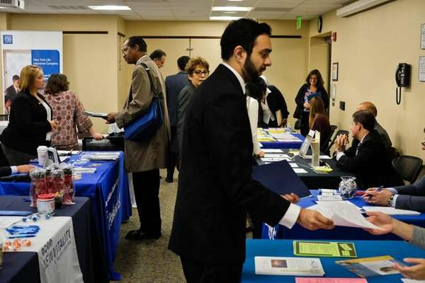 Employment seekers attend a job fair at the