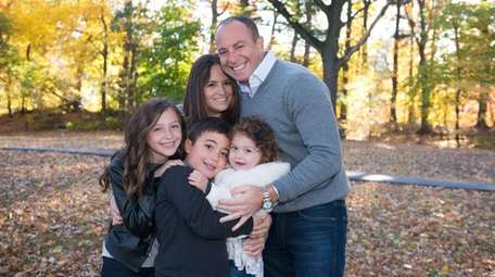 Holly Rizzuto Palker with her family in 2015.
