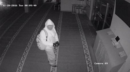 A surveillance photo shows a masked man Suffolk