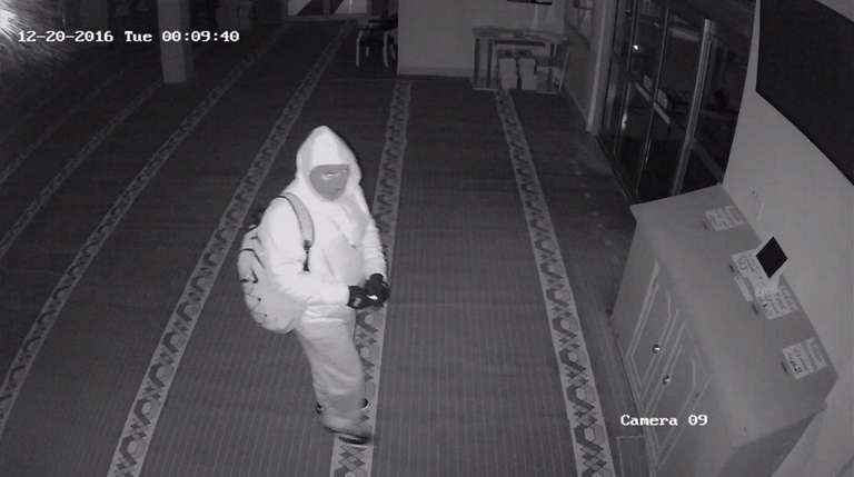 A surveillance photo shows a masked man Suffolk
