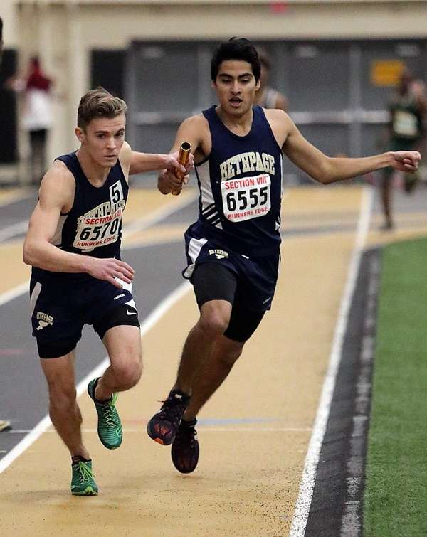 Bethpage's Justin Cano hands off the baton to